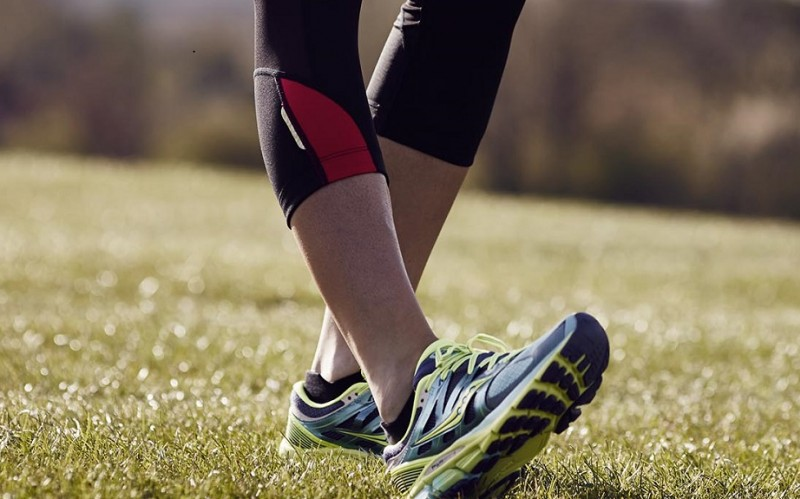 image of runner flexing their foot