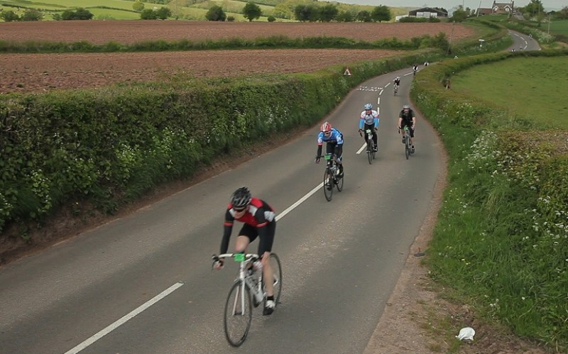 Cyclists riding along a main country road